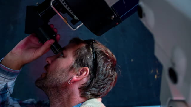 Man looking at the sky trough telescope video
