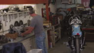Man looking for automobile parts video
