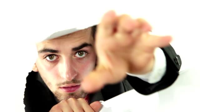Man Looking Through Torn Paper video
