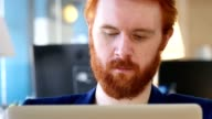 Man Looking toward Camera, Working in Office video