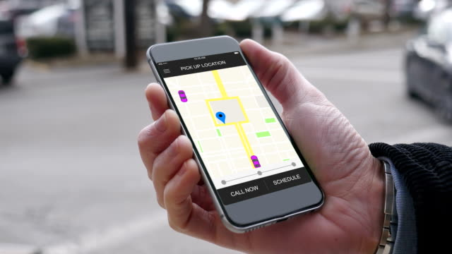 Man Looks at Ride Sharing Traffic Patterns on Smartphone video