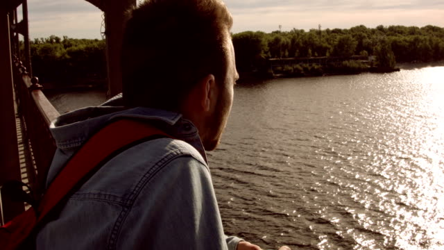 Man looks at the river at dawn video