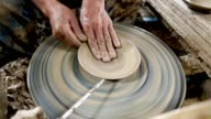 Man made the earthenware by mechanic pottery working with potter's wheel video