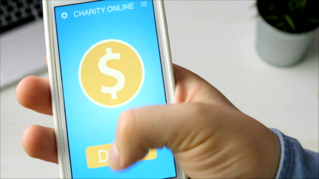 Man making an online donation using charity applicaiton on smartphone video