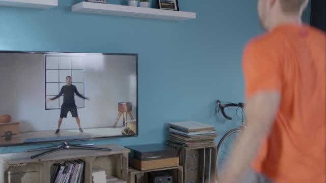 Man making jumping jack video