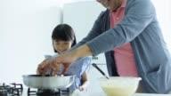 Man Making Pancakes With Granddaughter video