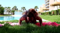 Man making some pushups with his girl on the back video