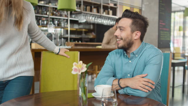 Man Meeting with Girlfriend at Cozy Coffee Shop video