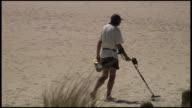(HD1080) Man Metal Detecting on Beach video