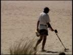 Man Metal Detecting on Beach video