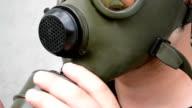 Man Mount Air Filter on Gas Mask video