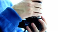 Man mounting a lens video