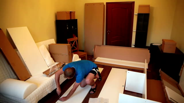 Man mounts the wardrobe at home. video
