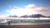 Man near the lake with glaciers video