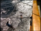 Man Net-Surfing Water off side of Boat video