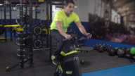 Man on a spinning bike at the gym video
