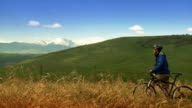 Man on bike in wilderness setting. video
