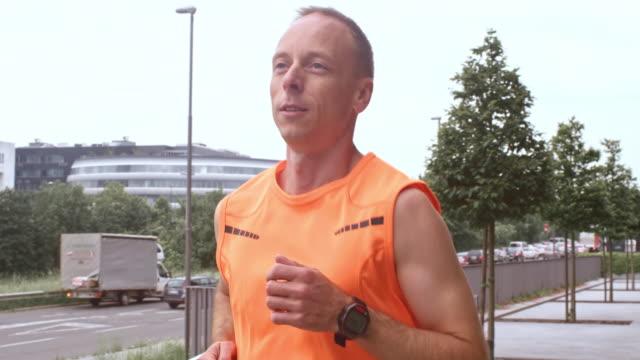 SLO MO TS Man on his morning run through city video