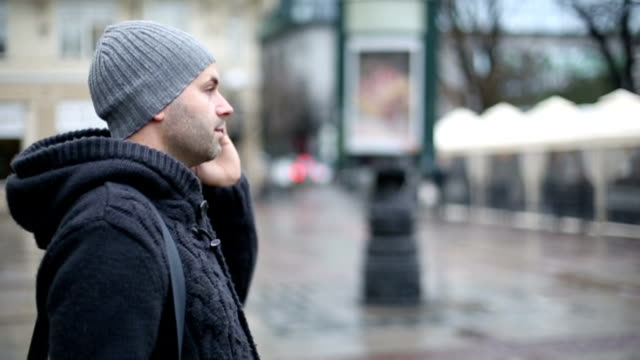 Man on the phone outside video