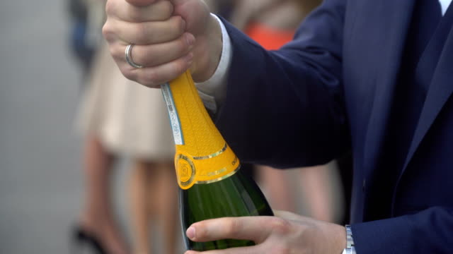 Man Opens A Bottle Of Champagne video