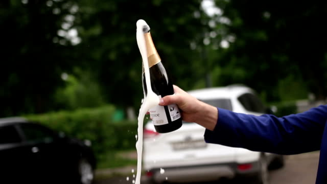 A man opens a bottle of sparkling wine video