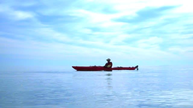 Man paddle kayak on sea. Kayaking. Kayak paddle. Man kayaking on blue sea video
