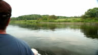Man paddling in kayak on calm waters of the Ugra-river in Russia. video
