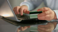 Man paying bill, shopping online, inserting credit card number video