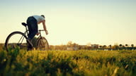 Man pedalling his bicycle on on a field video