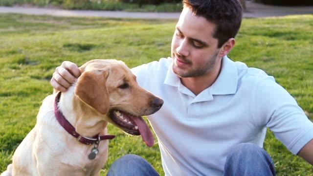 Man Petting Dog video