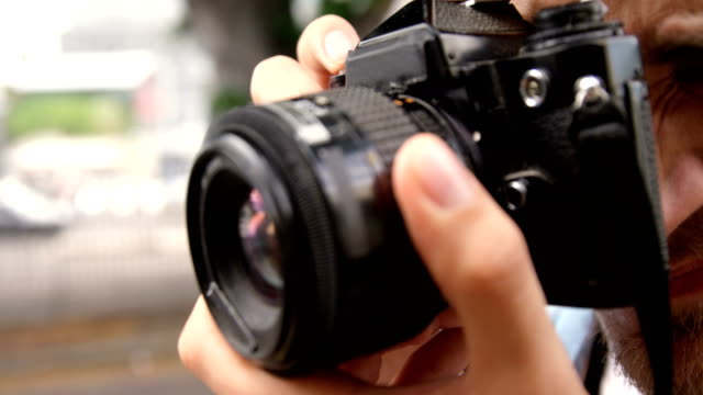 Man photographing with a camera video