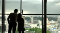 A man photographs the view from the window. video