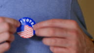 Man Places I Voted Sticker on Chest video