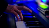 Man Play on Electric Piano Colorful Light video