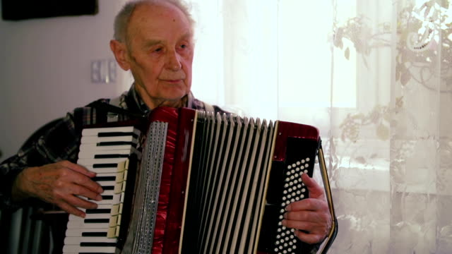 Man playing accordion video