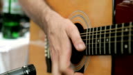 Man playing acoustic guitar video