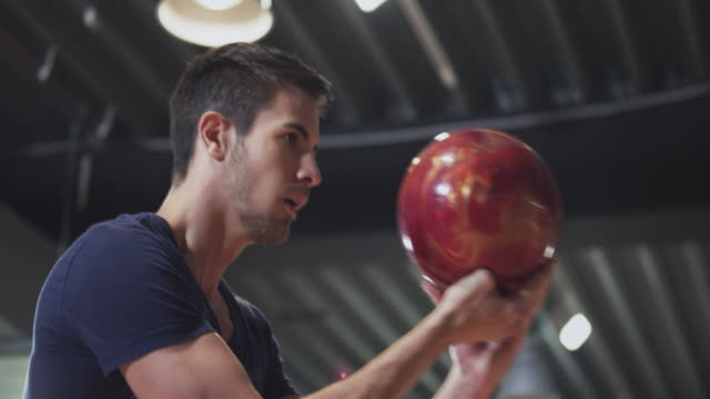 Man playing Bowling video