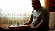 Man playing chess at home video