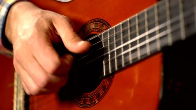 man playing classical guitar video