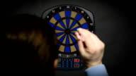 man playing darts video