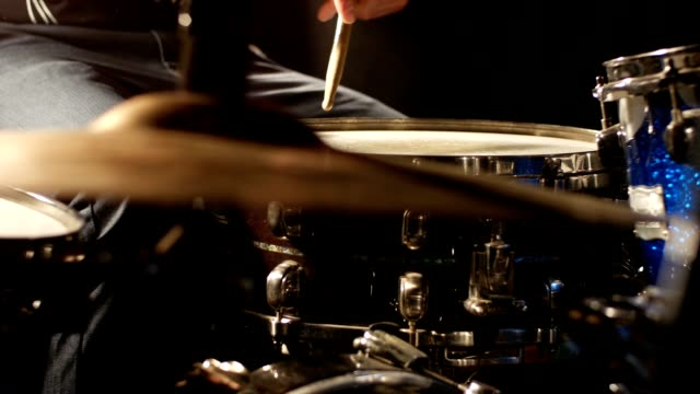 Man playing drums with sound - closeup video