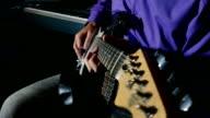 man playing electric guitar recording studio video
