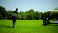 A man playing golf at the course video