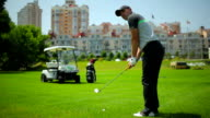 Man playing golf at the golf field video