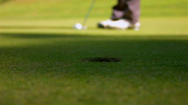 Man playing golf video