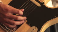 Man Playing guitar close-up video