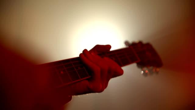Man playing guitar close-up video