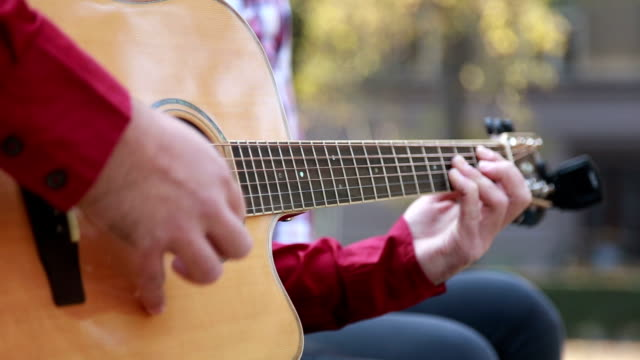 Man playing guitar while woman snapping fingers video