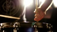 Man playing on snare drum with sound - closeup video