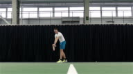 Man playing tennis. Slow motion video